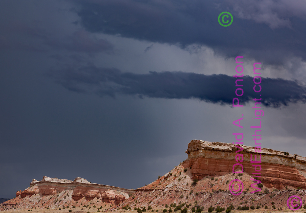Stormy sky over stratified sandstone formations west of San Ysidro, NM, © 2010 David A. Ponton