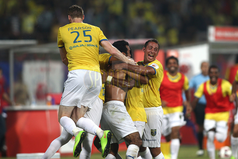 Ishfaq Ahmed of Kerala Blasters FC is congratulated by Stephen Pearson of Kerala Blasters FC and Michael Chopra of Kerala Blasters FC for scoring the opening goal during the 1st Semi Final match of the Hero Indian Super League between Kerala Blasters FC and Chennaiyin FC held at the Jawaharlal Nehru Stadium, Kochi, India on the 13th December 2014.<br /> <br /> Photo by:  Shaun Roy/ ISL/ SPORTZPICS