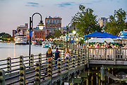 Locals and tourists alike intermingle as they meander down Wilmington's Cape Fear Riverwalk stopping for appetizers as the sun sets. PHOTO BY:  JEFF JANOWSKI PHOTOGRAPHY