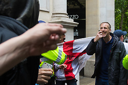London, June 24th 2017. Anti-fascist protesters counter demonstrate against a march to Parliament by the far right anti-Islamist English Defence League. PICTURED: An EDL supporter taunts anti-fascists during a scuffle near Trafalgar Square.