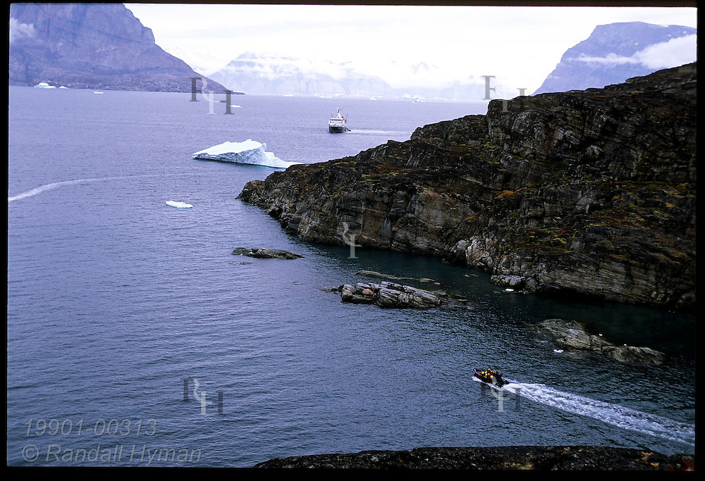 Rubber Zodiac raft ferries passengers back to cruise ship from Qilakitsoq mummy site near Uummannaq Island, Greenland.