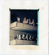 Teapots on a shelf ready to serve mint tea, Morocco<br />