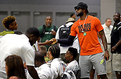 July 21, 2017 - Charlotte, NC, USA - LeBron James Jr., left and his dad, NBA star LeBron James, right, shake hands prior to tipoff of a youth tournament game at the Charlotte Convention Center in Charlotte, N.C., on Friday, July 21, 2017. (Credit Image: © Jeff Siner/TNS via ZUMA Wire)