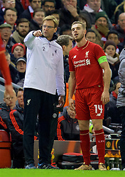 LIVERPOOL, ENGLAND - Thursday, March 10, 2016: Liverpool's manager Jürgen Klopp issues instructions to captain Jordan Henderson during the UEFA Europa League Round of 16 1st Leg match against Manchester United at Anfield. (Pic by David Rawcliffe/Propaganda)