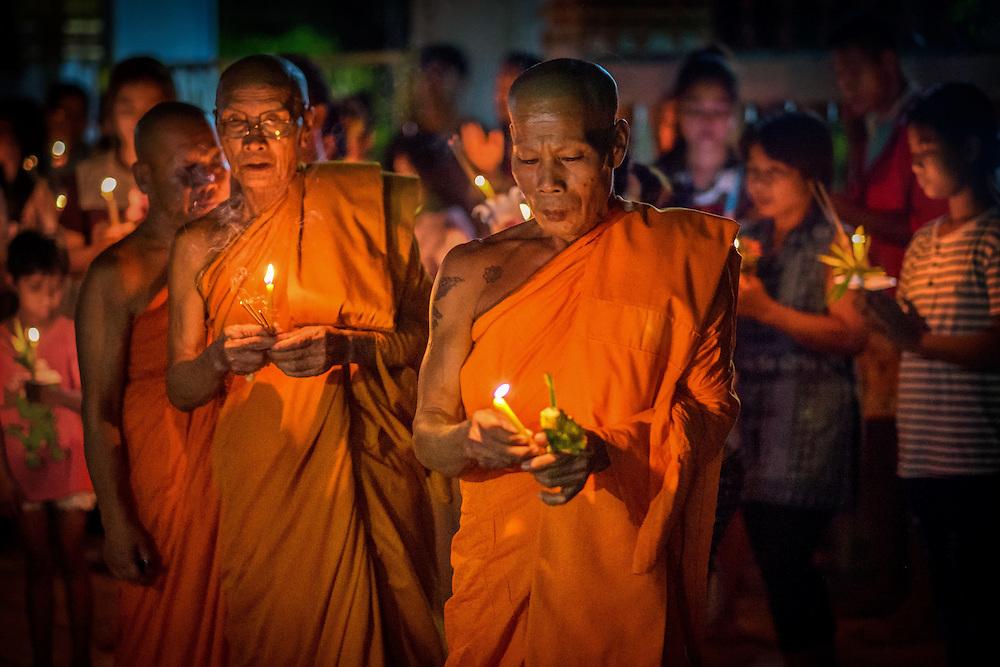 Thai Buddhist monks lead a procession around the ordination hall during Visakha Bucha Day celebrations in Nakhon Nayok, ‪Thailand‬ May 20, 2016. PHOTO BY LEE CRAKER