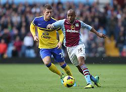 Aston Villa's Fabian Delph beats Everton's Ross Barkley for pace - Photo mandatory by-line: Matt Bunn/JMP - Tel: Mobile: 07966 386802 26/10/2013 - SPORT - FOOTBALL - Villa Park - Birmingham - Aston Villa v Everton - Barclays Premier League