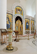 Iconostasis in the Narthex of the Cathedrale de la Sainte-Trinite de Paris, or Holy Trinity Cathedral of the Russian Orthodox Church, built 2013-16, on Quai Branly, in the 7th arrondissement of Paris, France. This room is plastered and lined with frescoes on a gold background, centred around the iconostasis. On the left is a manoualia, a large brass candle holder. The cathedral is part of a complex with the Centre Spirituel et Culturel Orthodoxe Russe, promoting Russian cultural religious heritage. Picture by Manuel Cohen