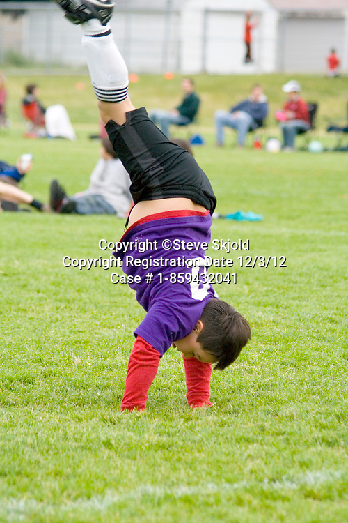 Athletic young soccer player cartwheeling during break in game. Carondelet Field by Expo School St Paul Minnesota MN USA