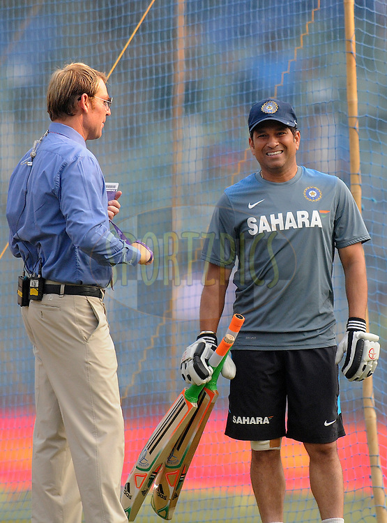 Sachin Tendulkar of India is seen with Shane Warne before the start of the play on day two of the second Star Sports test match between India and The West Indies held at The Wankhede Stadium in Mumbai, India on the 15th November 2013<br /> <br /> This test match is the 200th test match for Sachin Tendulkar and his last for India.  After a career spanning more than 24yrs Sachin is retiring from cricket and this test match is his last appearance on the field of play.<br /> <br /> <br /> Photo by: Pal PIllai - BCCI - SPORTZPICS<br /> <br /> Use of this image is subject to the terms and conditions as outlined by the BCCI. These terms can be found by following this link:<br /> <br /> http://sportzpics.photoshelter.com/gallery/BCCI-Image-Terms/G0000ahUVIIEBQ84/C0000whs75.ajndY