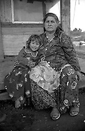 Rome  April 1999.Grandmother and grandson, rom Bosnian, in the Rom's camp  Casilino 700.
