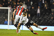 Fulham Forward Aleksandar Mitrovic (32) and Sheffield United Defender Richard Stearman (19) battle for the ball during the EFL Sky Bet Championship match between Fulham and Sheffield United at Craven Cottage, London, England on 6 March 2018. Picture by Stephen Wright.