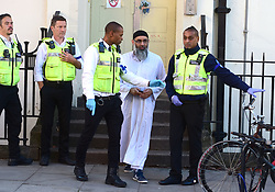 Anjem Choudary leaves a bail hostel in north London after his release from Belmarsh Prison.