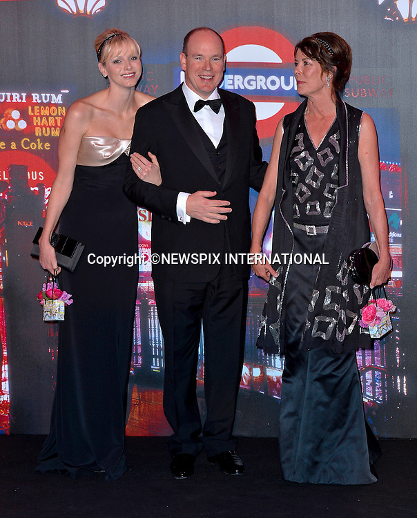 "PRINCESS CHARLENE, PRINCE ALBERT AND PRINCESS CAROLINE OF MONACO.attend one of the Principality's premiere event the ""Bal de la Rose"" (Monaco Rose Ball).The theme for this year's Ball that raise funds for the Princess Grace Foundation was ""Swinging London""_Monte Carlo, 24/03/2012.Mandatory Credit Photos: SBM/Newspix International..**ALL FEES PAYABLE TO: ""NEWSPIX INTERNATIONAL""**..PHOTO CREDIT MANDATORY!!: NEWSPIX INTERNATIONAL(Failure to credit will incur a surcharge of 100% of reproduction fees)..IMMEDIATE CONFIRMATION OF USAGE REQUIRED:.Newspix International, 31 Chinnery Hill, Bishop's Stortford, ENGLAND CM23 3PS.Tel:+441279 324672  ; Fax: +441279656877.Mobile:  0777568 1153.e-mail: info@newspixinternational.co.uk"