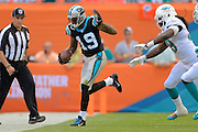 Carolina Panthers wide receiver Ted Ginn (19) runs upfield during the Panthers game against the Miami Dolphins at SunLife Stadium on Nov. 24, 2013 in Miami Gardens, Florida. <br /> <br /> &copy;2013 Scott A. Miller