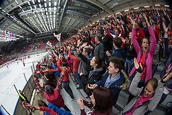 Spectators during ice hockey match between HDD SIJ Acroni Jesenice and HDD Telemach Olimpija in 4th leg of Finals of Slovenian National Championship 2014/2015, on April 15, 2015 in Podmezakla, Jesenice, Slovenia. Photo by Grega Valancic / Sportida