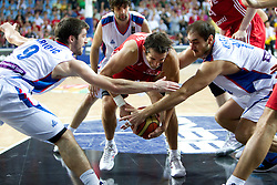Kerem Tunceri of Turkey between Stefan Markovic of Serbia and Nenad Krstic of Serbia during the second semifinal basketball match between National teams of Serbia and Turkey at 2010 FIBA World Championships on September 11, 2010 at the Sinan Erdem Dome in Istanbul, Turkey. Turkey defeated Serbia 83 - 82 and qualified to finals.  (Photo By Vid Ponikvar / Sportida.com)