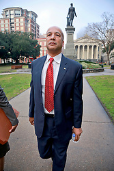 27 January 2014. New Orleans, Louisiana. <br /> Ray Nagin, former mayor of New Orleans walks to Federal court surrounded by his lawyers and media as his corruption trial starts at the Federal Courthouse. Nagin is charged with 21counts of corruption including  bribery, conspiracy, money laundering and wire fraud. <br /> Photo; Charlie Varley