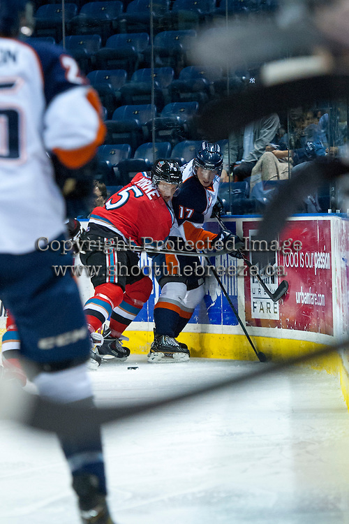 KELOWNA, CANADA - AUGUST 30:  Dalton Yorke #5 of the Kelowna Rockets checks Luke Harrison #17 of the Kamloops Blazers into the boards on August 30, 2014 during pre-season at Prospera Place in Kelowna, British Columbia, Canada.   (Photo by Marissa Baecker/Shoot the Breeze)  *** Local Caption *** Dalton Yorke, Luke Harrison;