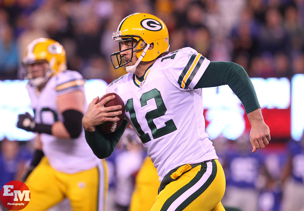Dec 4, 2011; East Rutherford, NJ, USA; Green Bay Packers quarterback Aaron Rodgers (12) runs with the ball during the second half at MetLife Stadium. The Packers defeated the Giants 38-35.