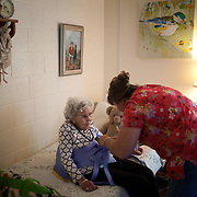 NURSING HOME<br /> <br /> Alice Jacobs, 90, is assisted into a harness so she can be lifted into her wheelchair by Certified Nursing Assistants (CNA) Lisa Settle (red shirt) at the Dogwood Village assisted living facility Friday, June 23, 2017, in Orange, VA.  Jacobs once owned a factory and horses, raised four children and buried two husbands.  But years in an assisted living facility drained her savings, and now, she relies on Medicaid to pay for her care.<br /> <br /> Photo by Khue Bui