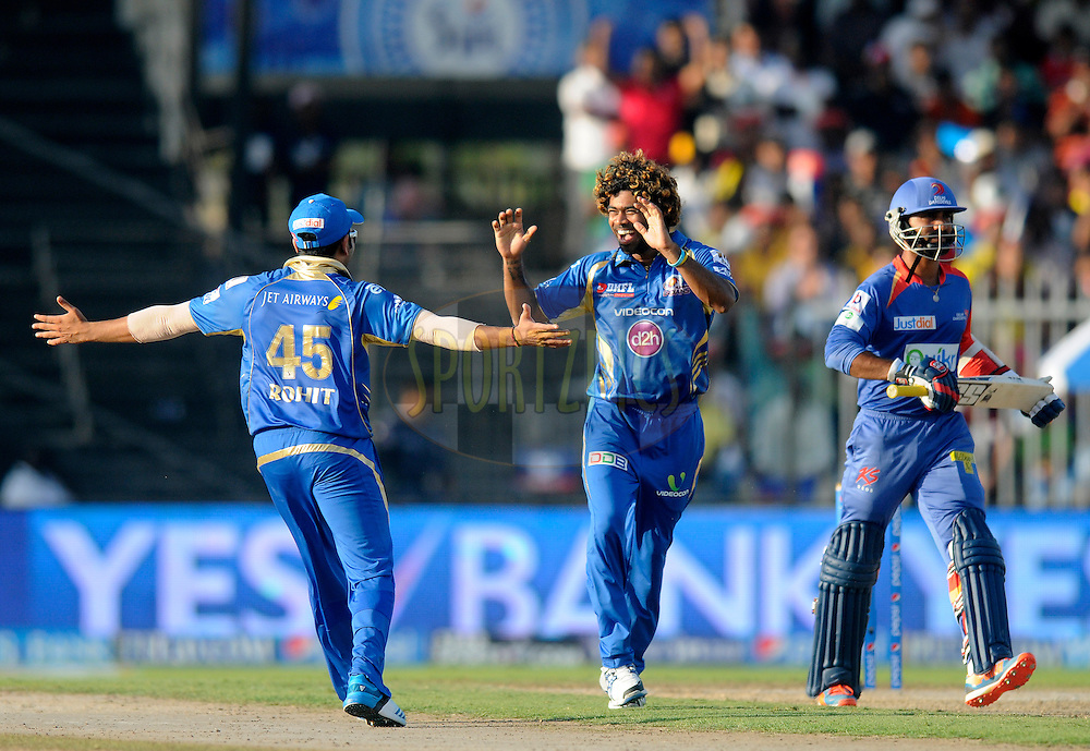 Lasith Malinga of the Mumbai Indians celebrates the wicket of  Dinesh Karthik of the Delhi Daredevils during match 16 of the Pepsi Indian Premier League 2014 between the Delhi Daredevils and the Mumbai Indians held at the Sharjah Cricket Stadium, Sharjah, United Arab Emirates on the 27th April 2014<br /> <br /> Photo by Pal Pillai / IPL / SPORTZPICS
