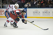 Amerks defenseman Chad Ruhwedel chases Springfield's Brendan Shinnimin into the Amerks zone during a game at the Blue Cross Arena in Rochester on Friday, March 4, 2016.