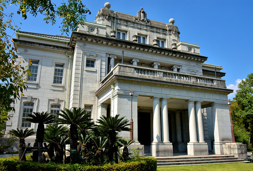 Former Kagoshima Prefectural Office in Kagoshima, Japan<br /> The Former Kagoshima Prefectural stands in sharp contrast to the modern façade of its neighbor, the Kagoshima Prefectural Exchange Center. This Western-style, Neoclassical design was created by Sone Tatsuzō in 1925. Also spelled Tatsuzo Stone, he was one of the most accomplished Japanese architects of the late Meiji period. This structure is now the Prefectural Government Memorial Hall.