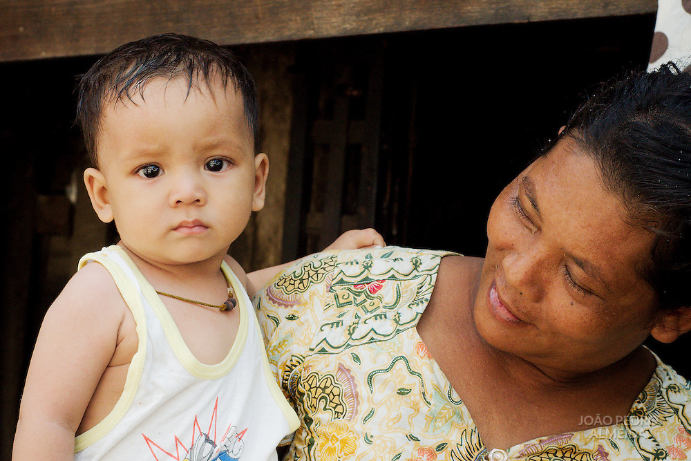 Woman with child at house in Mandalay