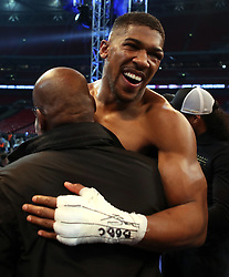 Anthony Joshua post fight with family members following his victory over Wladimir Klitschko for the IBF, WBA and IBO Heavyweight World Titles at Wembley Stadium, London.
