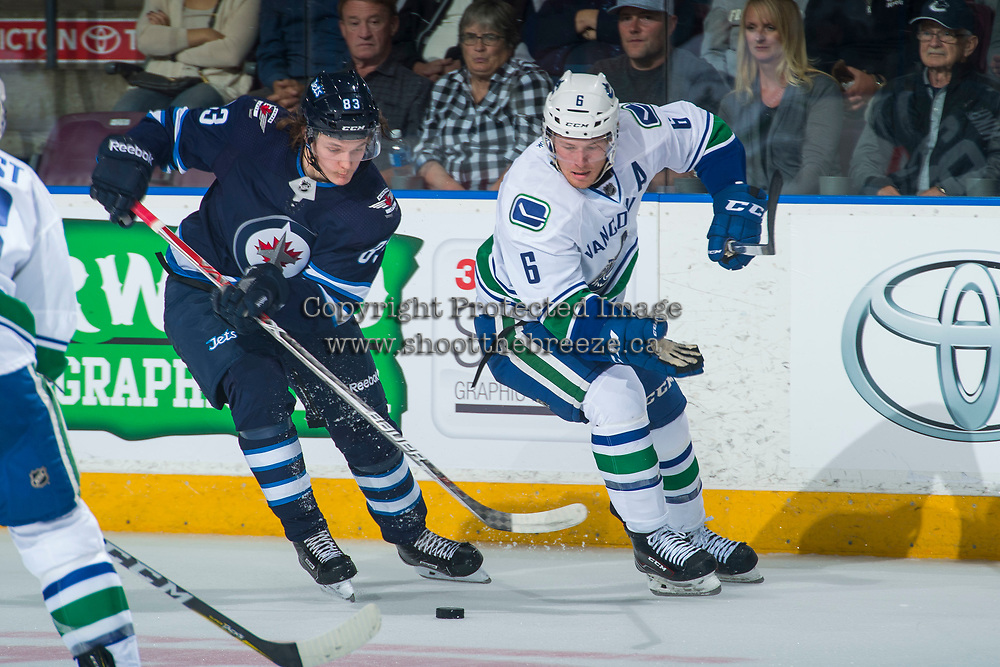 PENTICTON, CANADA - SEPTEMBER 8: Sami Niku #83 of Winnipeg Jets moves the puck away from Brock Boeser #6 of Vancouver Canucks on September 8, 2017 at the South Okanagan Event Centre in Penticton, British Columbia, Canada.  (Photo by Marissa Baecker/Shoot the Breeze)  *** Local Caption ***