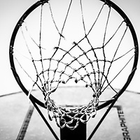 strings and basketball hoop in black and white