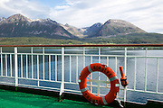 Steep mountains of Grytoya island, Troms county, northern Norway from Hurtigruten ferry ship Nordlys