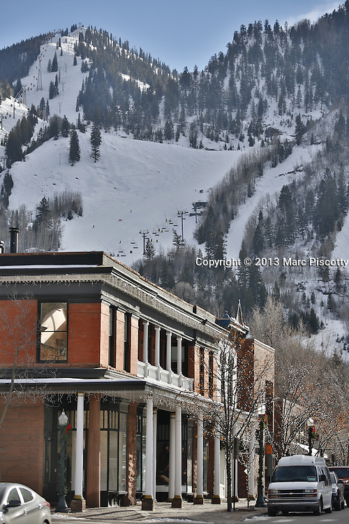 """SHOT 12/1/13 3:23:10 PM - Aspen is a city in and the county seat of Pitkin County, Colorado, United States. It is situated in a remote area of the Rocky Mountains' Sawatch Range and Elk Mountains, along the Roaring Fork River at an elevation just below 8,000 feet. Founded as a mining camp during the Colorado Silver Boom and later named """"Aspen"""" because of the abundance of aspen trees in the area, the city boomed during the 1880s and later busted when the silver market collapsed. Aspen's fortunes reversed in the mid-20th century when neighboring Aspen Mountain was developed into a ski resort and industrialist Walter Paepcke bought many properties in the city and redeveloped them. As a result of this influx of wealth Aspen boasts some of the most expensive real estate prices in the United States. (Photo by Marc Piscotty / © 2013)"""