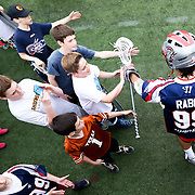Paul Rabil #99 of the Boston Cannons greets his fans during the game at Harvard Stadium on May 10, 2014 in Boston, Massachusetts. (Photo by Elan Kawesch)