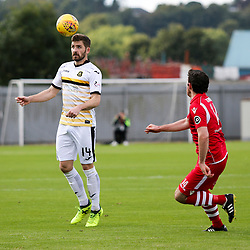 Kyle Hutton heads forward during the Dumbarton v Connah's Quay Nomads Irn Bru cup second round 2 September 2017<br /> <br /> <br /> <br /> <br /> (c) Andy Scott | SportPix.org.uk