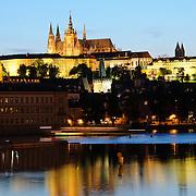 Prague Castle at dusk with reflection on Vltava River