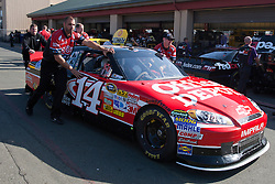 June 25, 2011; Sonoma, CA, USA;  Crew members push the car of NASCAR Sprint Cup Series driver Tony Stewart (not pictured) through the garage area during practice for the Toyota/Save Mart 350 at Infineon Raceway.