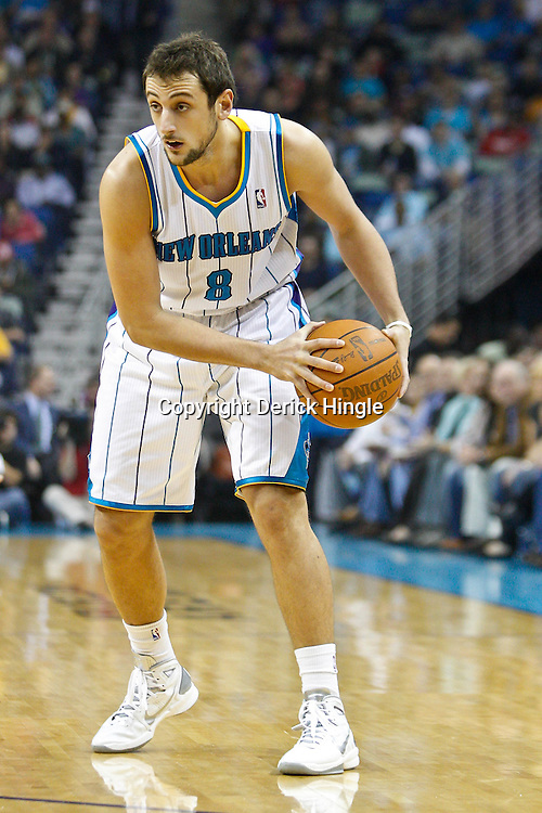 January 24,  2011; New Orleans, LA, USA; New Orleans Hornets shooting guard Marco Belinelli (8) against the Oklahoma City Thunder during the first quarter at the New Orleans Arena. Mandatory Credit: Derick E. Hingle