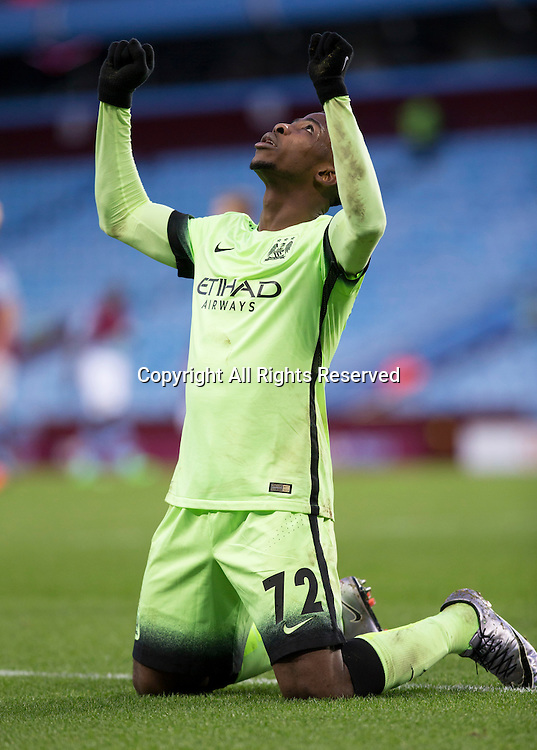 30.01.2016. Villa Park, Birmingham, England. Emirates FA Cup 4th Round. Aston Villa versus Manchester City. Manchester City striker Kelechi Iheanacho kneels on the ground raising his arms as he looks above after he scored his hat trick in the 74th minute.