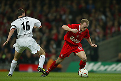 CARDIFF, WALES - Sunday, March 2, 2003: Liverpool's Danny Murphy turns inside Manchester United's Roy Keane during the Football League Cup Final at the Millennium Stadium. (Pic by David Rawcliffe/Propaganda)