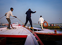 Varanasi, INDIA - CIRCA NOVEMBER 2018: Boatmen of Varanasi with their boats at  Ganges River. Varanasi is the spiritual capital of India, the holiest of the seven sacred cities and with that one the most frequented places for Sadhus.