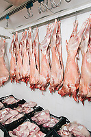 NAPLES, ITALY - 16 APRIL 2019: Goat meat is seen here in the cold storage room of the Macelleria Iavarone, a butcher shop in the market of the Borgo of Sant'Antonio Abate (called Buvero in Neapolitan), in Naples, Italy, on April 26th 2019.