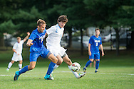 9/12/15 – Medford/Somerville, MA – Tufts midfielder Scott Sclar, A18, fights for possession in the 2-0 season-opening victory against the Colby Mules on Saturday, Sep. 12, 2015. (Evan Sayles / The Tufts Daily)