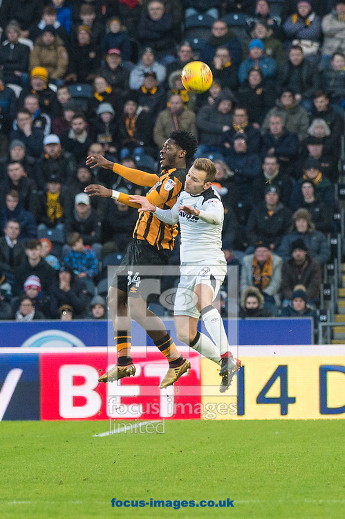 Ola Aina of Hull City in an aerial challenge with Chris Martin of Derby County during the Sky Bet Championship match at the KCOM Stadium, Hull<br /> Picture by Matt Wilkinson/Focus Images Ltd 07814 960751<br /> 26/12/2017