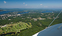 A beautiful day in the neighborhood as Lakes Biplane takes flight over Pheasant Ridge Golf Course with Winnisquam, Opechee and Paugus Bay on the horizon Thursday, August 22, 2012.  (Karen Bobotas/for the Laconia Daily Sun)