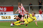 Kyle Storer and Simon Heslop during the Vanarama National League match between Torquay United and Cheltenham Town at Plainmoor, Torquay, England on 29 August 2015. Photo by Antony Thompson.