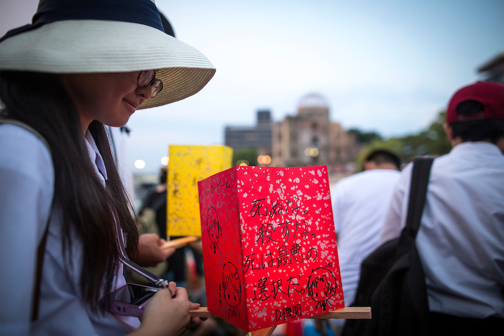 HIROSHIMA, JAPAN - AUGUST 6 : A student wait to float candle lit lantern with her written message on the Motoyasu River during the 71st anniversary activities, commemorating the atomic bombing of Hiroshima at the Hiroshima Peace Memorial Park on August 6, 2016 in Hiroshima, western Japan. Japan marks the 71st anniversary of the first atomic bomb that was dropped by the United States on Hiroshima on August 6, 1945 during World War II.  (Photo by Richard Atrero de Guzman/NURPhoto)