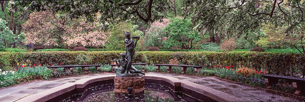 Burnett's 'Secret Garden' Memorial Fountain and Bird bath,  a bronze sculpture of two children, characters from Frances Hodgson Burnett's book The Secret Garden. The fountain was created by Bessie Potter Vonnoh, Central Park, Conservatory Garden, New York CIty, New YorK
