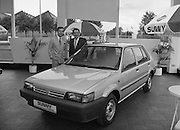 """Nissan Launches New """"Sunny""""..1986..21.08.1986..08.21.1986..21st August 1986..Nissan Ireland launched the all new integrated Sunny range on to the Irish market.The launch was the European premiere of this model and marked a significant second phase in the rationalisation of the Nissan Product range. The first Phase was the launch of the Bluebird range in February of this year. The Launch took place at Nissan House, Naas Road Dublin...Pictured admiring the new Nissan """"Sunny"""" hatchback were Mr Gerard O'Toole,Managing Director and Mr Michael Murphy,sales Director,Nissan Ireland."""