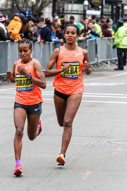 Boston Marathon: winner Caroline Rotich, Kenya, battles Ethiopians Dibaba and Deba with half mile to go